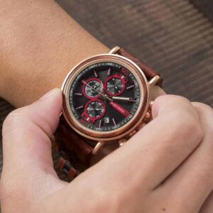 Man raises a left hand to watch time on BOBO BIRD wooden watches